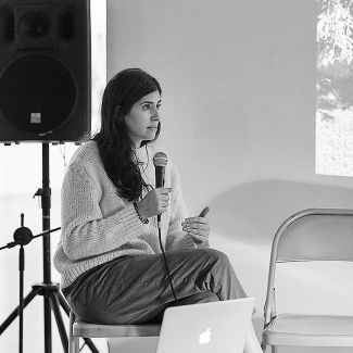 Laurence Rasti on the FOTODOKS stage discussing her project 'There are no homosexuals in Iran' (photo: Franziska Schrödinger)